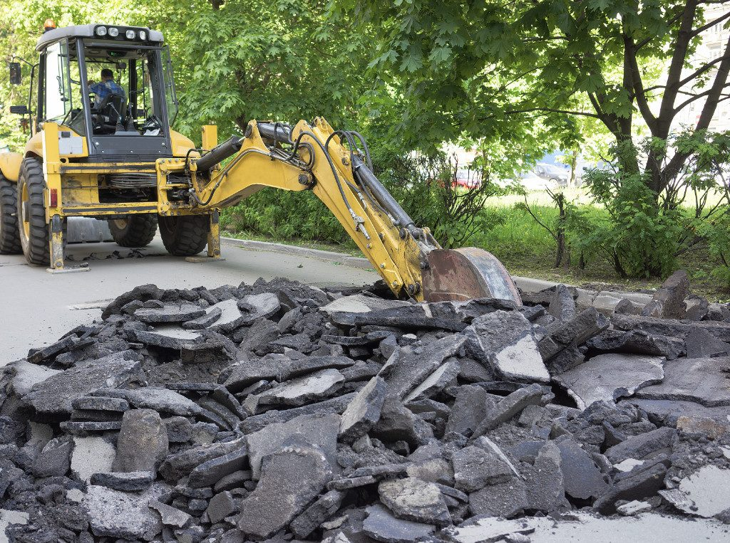 excavating asphalt for utility repair