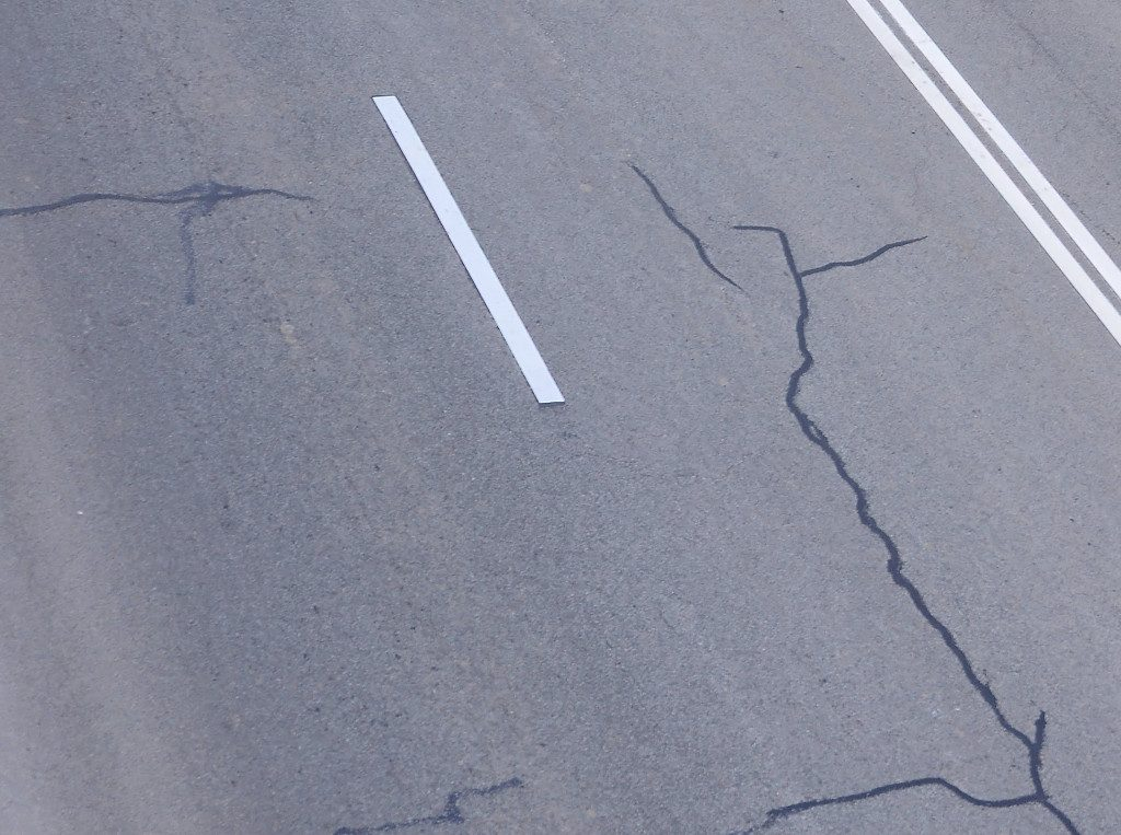 overhead view of road cracks filled