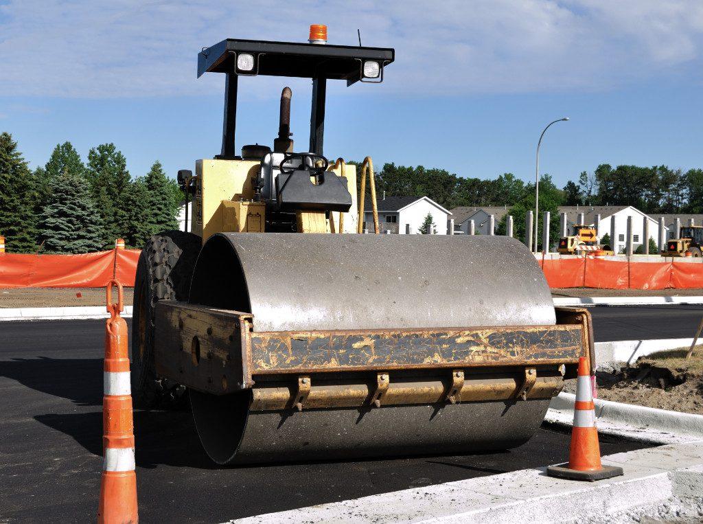 parked asphalt roller on new pavement