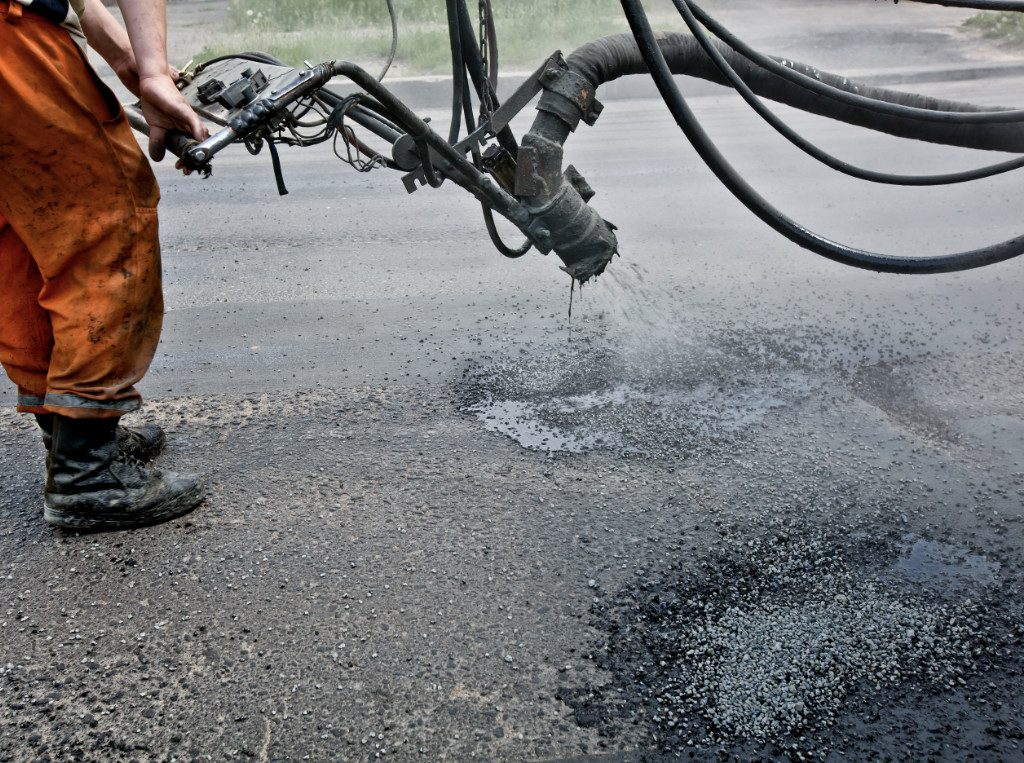 pothole tar spray